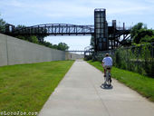 Riverfront Heritage trail and pedestrian  bridge across it.
